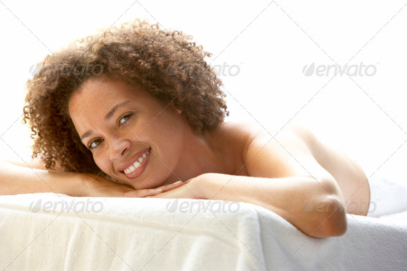 Young Woman Relaxing On Massage Table - Stock Photo - Images