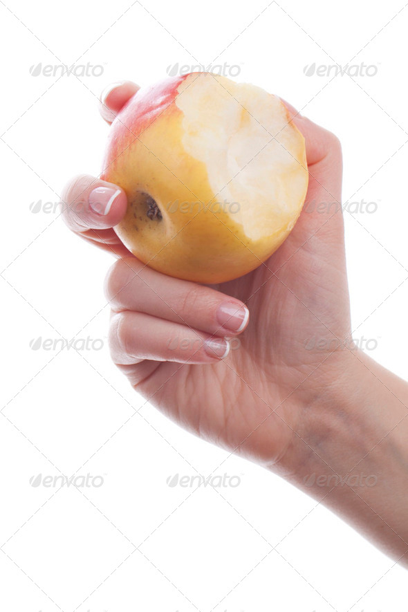 Hand with eaten apple - Stock Photo - Images
