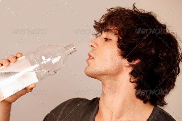 Hot guy drinking water - Stock Photo - Images