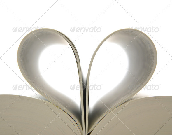 Book with opened pages and shape of heart  - Stock Photo - Images