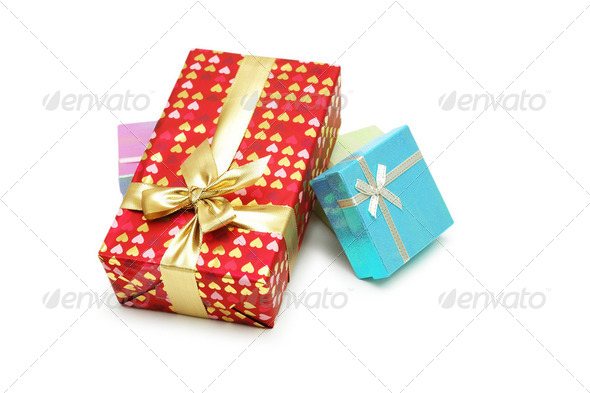 Gift boxes with shiny ribbons isolated on white - Stock Photo - Images