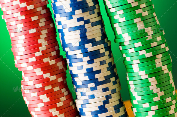 Stack of casino chips against gradient background - Stock Photo - Images