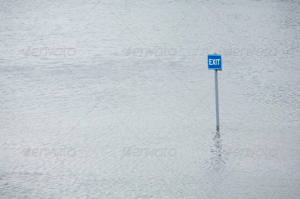 Exit sign in flooded car park - Stock Photo - Images