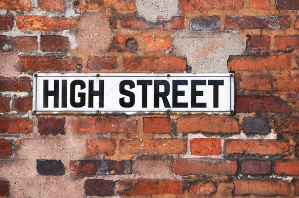 Rusty Metal High Street Road Sign On Brick Wall - Stock Photo - Images