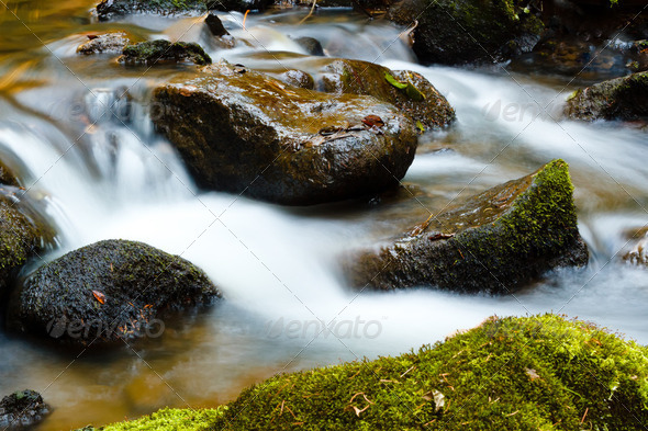 Falls on the small mountain river in a wood shooted in autumn - Stock Photo - Images