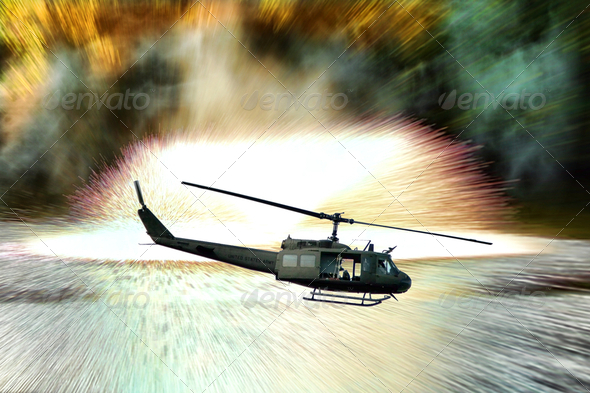 Army Helicopter in Combat Mission with Explosions - Stock Photo - Images