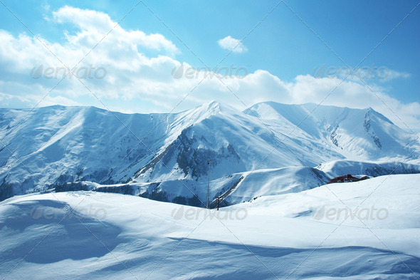 Mountains under the snow on a winter day - Stock Photo - Images