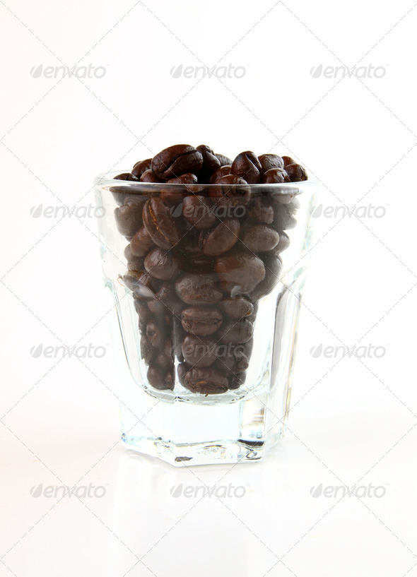 Coffee beans in a small glass on white background - Stock Photo - Images