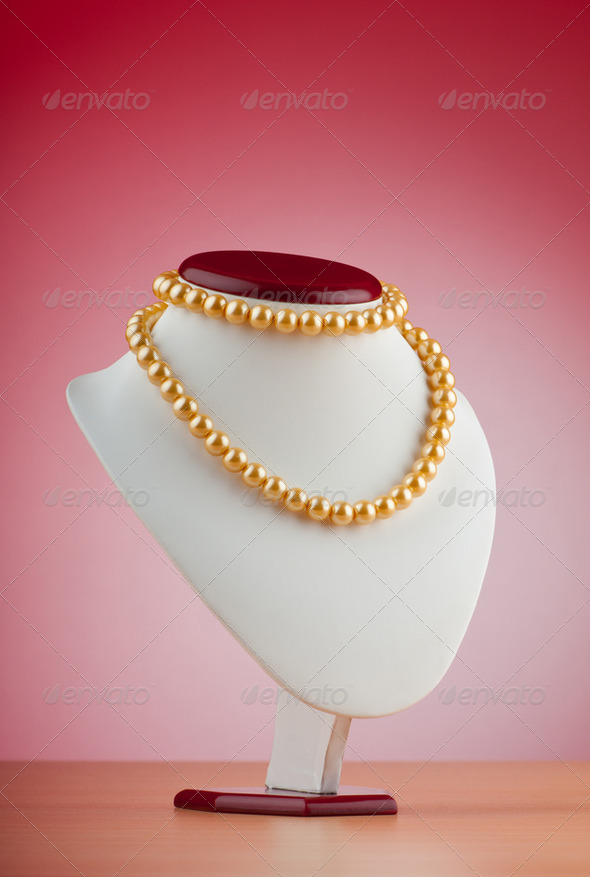 Pearl necklace against gradient background - Stock Photo - Images