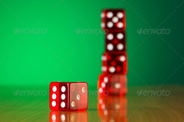 Stack of red casino dice against gradient background - Stock Photo - Images