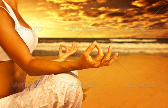 PhotoDune Yoga meditation on the beach 2153682