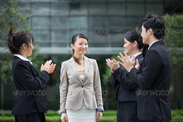 Asian business team congratulate a colleague. - Stock Photo - Images