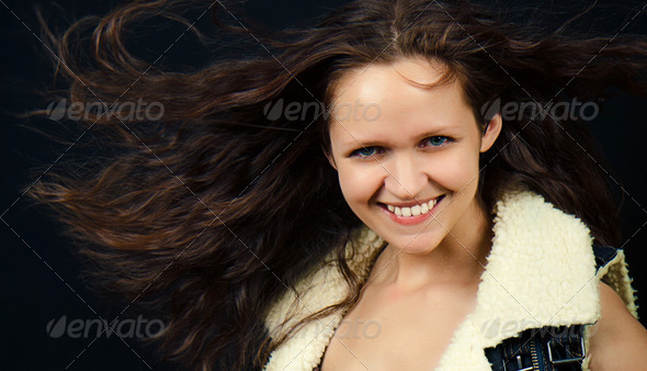 attractive girl with long hair in denim vest - Stock Photo - Images