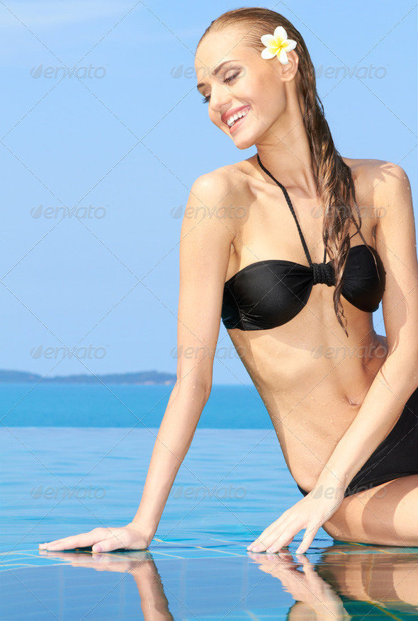 Smiling Woman Reflected In Pool - Stock Photo - Images