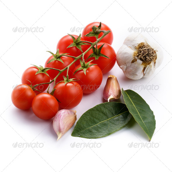 Cherry tomatoes garlic and bay leaf - Stock Photo - Images