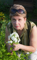 Portrait of a woman with a blooming phlox - PhotoDune Item for Sale