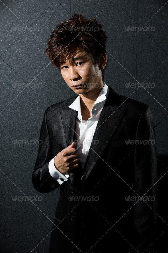 fashionable Asian man wearing stylish suit - Stock Photo - Images