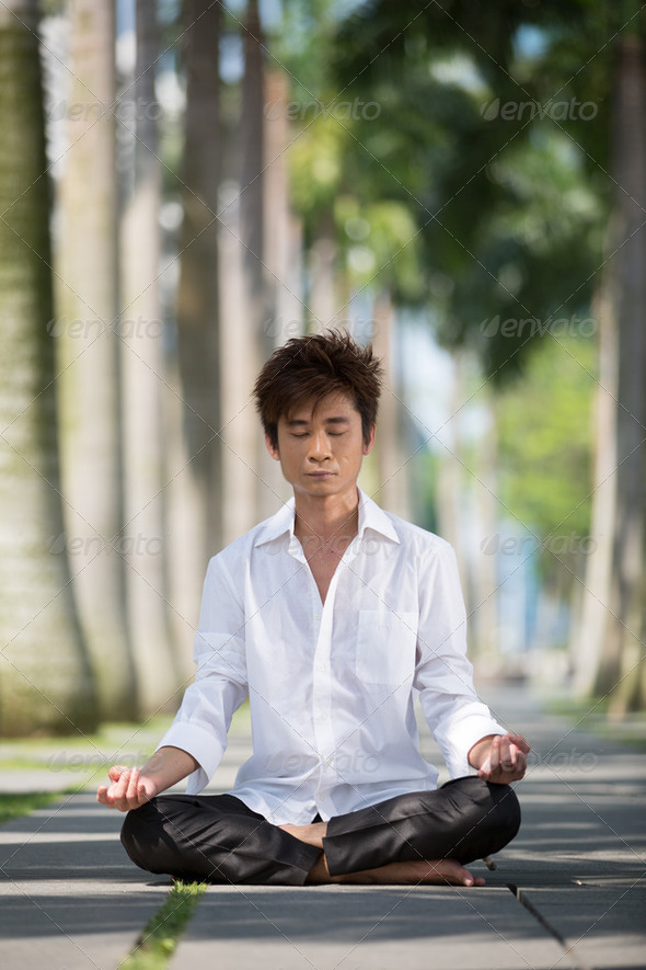 Asian business man meditating. - Stock Photo - Images