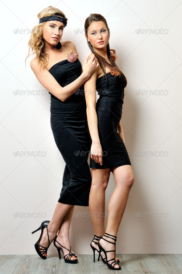 Two beautiful women in a black dresses. - Stock Photo - Images