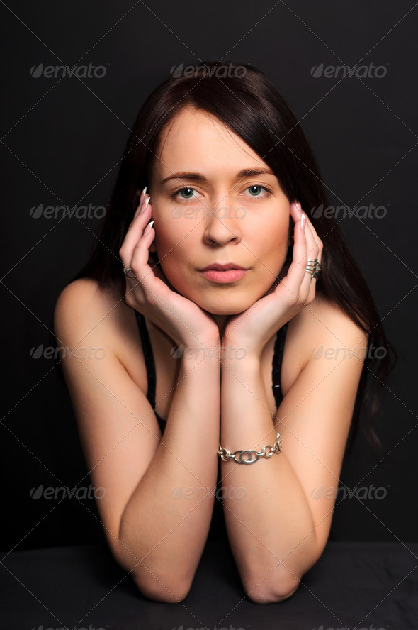 portrait brunette  woman on black background - Stock Photo - Images