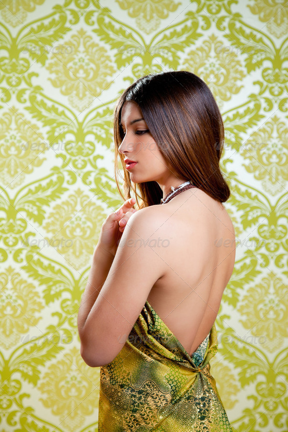 Asian Indian brunette beautiful girl sexy back dress - Stock Photo - Images