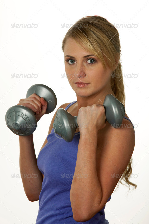 Woman exercising with weights - Stock Photo - Images