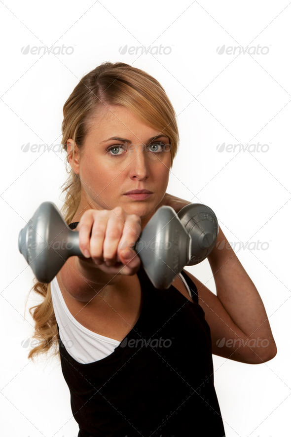 Young woman with dumbbells  - Stock Photo - Images