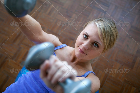 Young woman working out with dumbbells - Stock Photo - Images