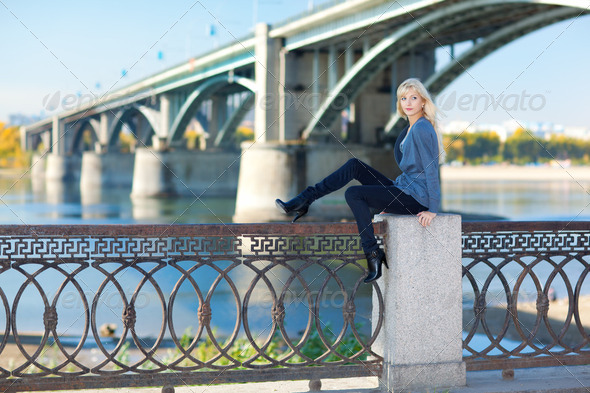 Beautiful woman with bridge on the background - Stock Photo - Images