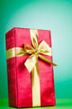 Celebration concept - Gift box against colorful background - PhotoDune Item for Sale