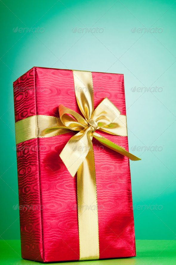 Celebration concept - Gift box against colorful background - Stock Photo - Images