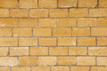 Brick wall made of light yellowish stones - PhotoDune Item for Sale