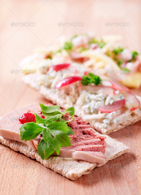 Crispbread with various toppings - Stock Photo - Images