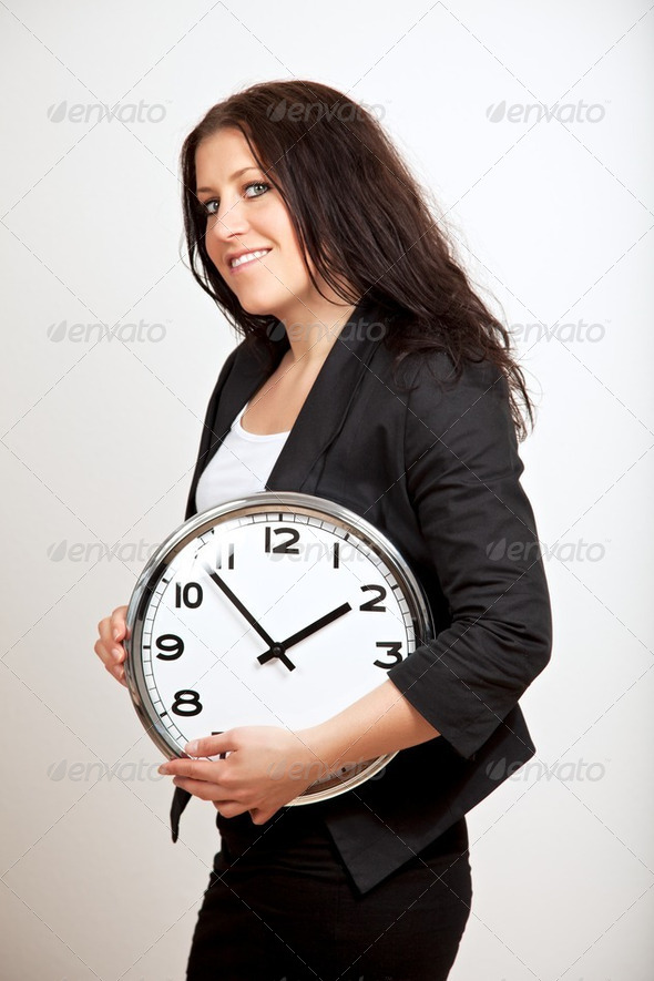 A Confident Woman Holding a Clock - Stock Photo - Images