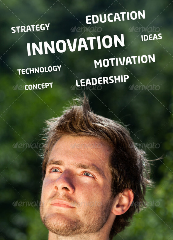 Young persons head looking at business icons and images - Stock Photo - Images
