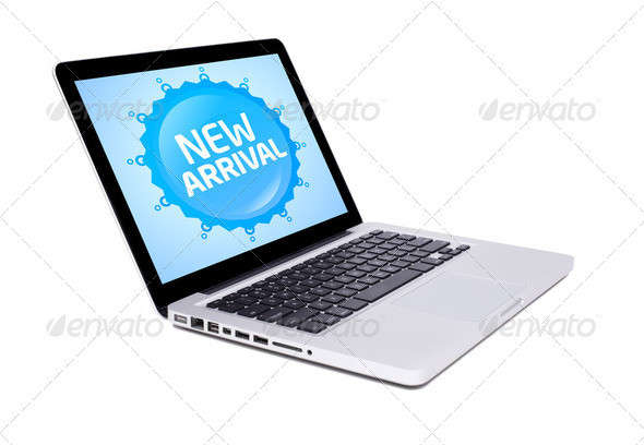 new laptop with new arrival sign - Stock Photo - Images