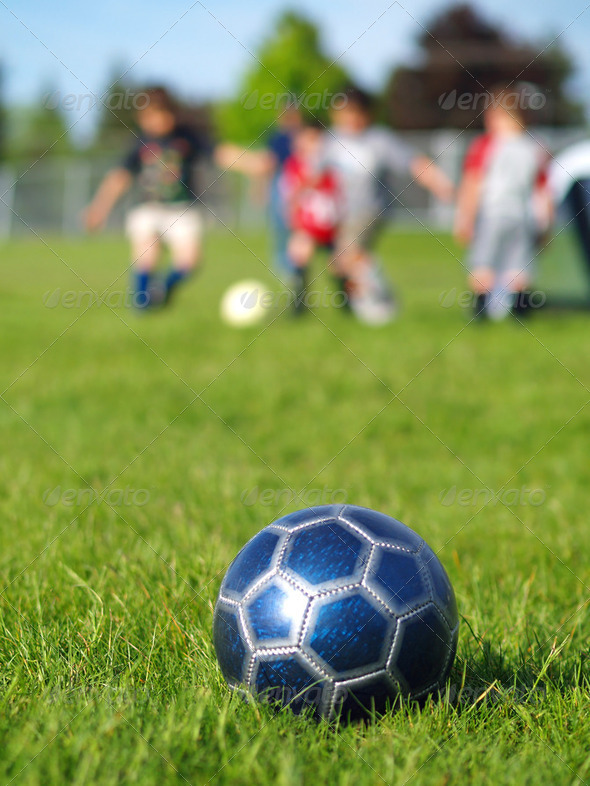 Blue Soccer Ball and Players - Stock Photo - Images