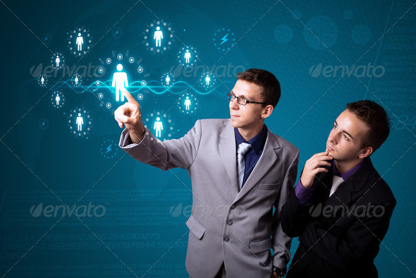 Businessman pressing modern social type of icons - Stock Photo - Images