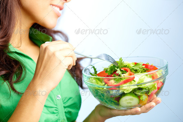 Eating salad - Stock Photo - Images