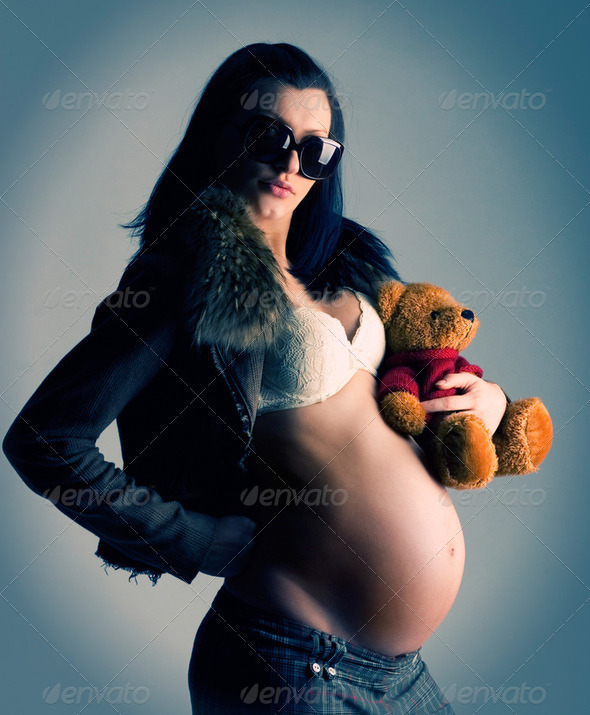 Pregnant woman with toy - Stock Photo - Images