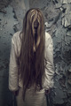 Zombie Girl With Loong Hair In An Abandoned Building - PhotoDune Item for Sale