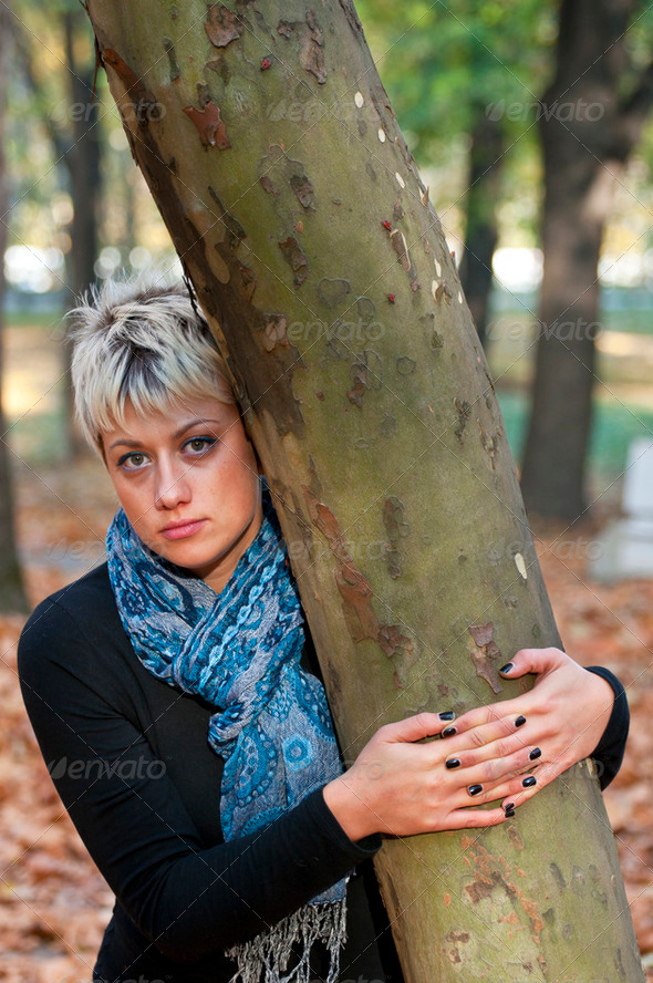 Portrait of beautiful blond woman in autumn forest - Stock Photo - Images