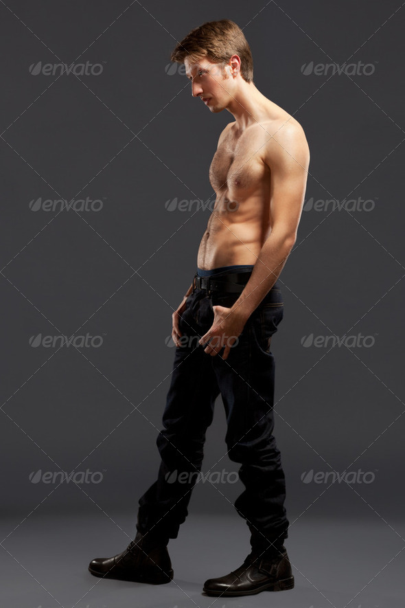 Full length portrait of a confident young men - Stock Photo - Images