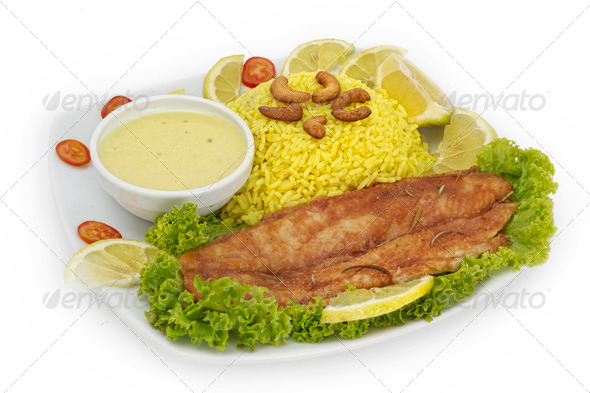 Plate with roasted fish, wild rice and vegetable garnish. - Stock Photo - Images