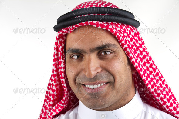 Portrait of a successful arabian business man smiling  - Stock Photo - Images
