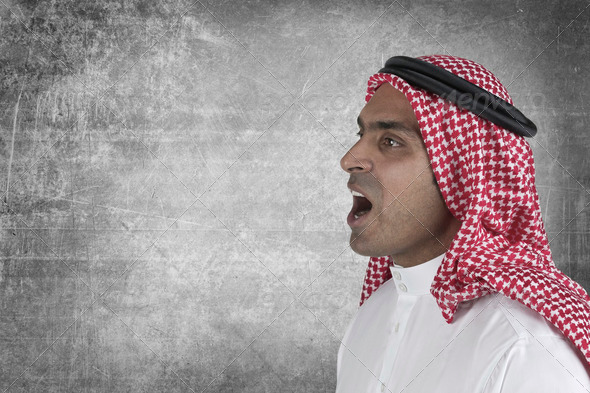 Young arabian man speaking with space to add suitable text - Stock Photo - Images