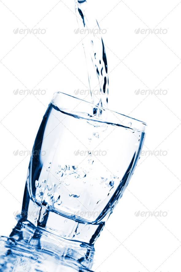 water splashing into glass isolated - Stock Photo - Images