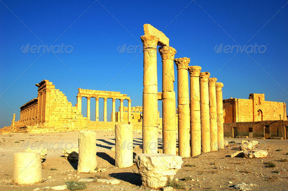 Relics Palmyra in Syria against blue sky. Ancient Roman time town in Palmyra (Tadmor), Syria. - Stock Photo - Images