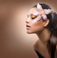 Beauty Portrait. Beautiful Stylish Girl with Orchid Flower - PhotoDune Item for Sale