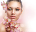 Beautiful Girl With Orchid Flowers. Perfect Make-up - PhotoDune Item for Sale